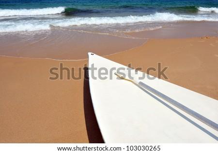 Mediterranean sea surfing board - Hasake lay on the beach. - stock photo