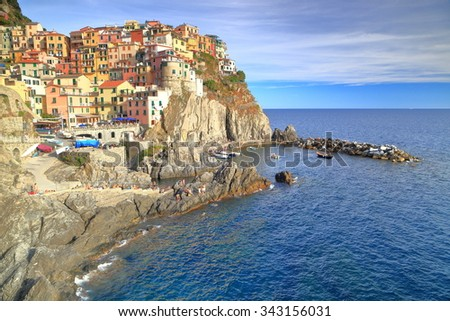 Mediterranean sea surrounding the harbor and old village of Manarola, Cinque Terre, Italy - stock photo