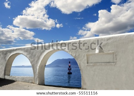 mediterranean sea view white arches architecture blue sky [Photo Illustration]