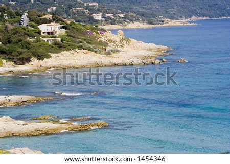 mediterranean seascape - steep coast and villas - stock photo
