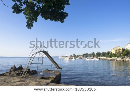 Mediterranean Seaside water slide Opatija Croatia - stock photo