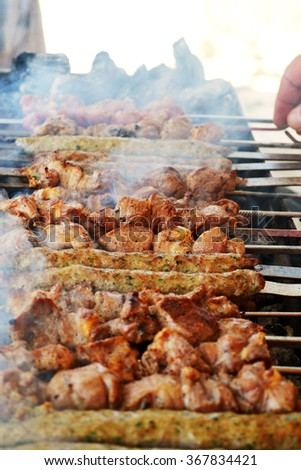 Mediterranean spicy Kebab meat being grilled in a restaurant outdoor - stock photo
