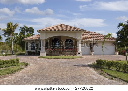 Mediterranean Style Home showing driveway and main entrance - stock photo