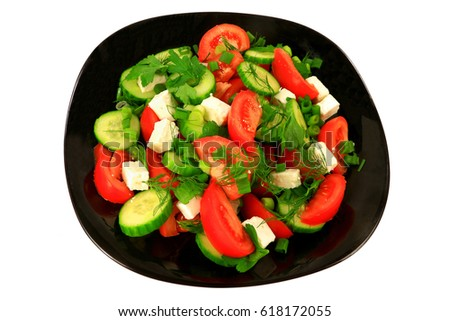 Mediterranean style salad from tomato wedges, sliced seedless