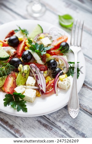 Mediterranean-style salad with feta and dried tomatoes - stock photo