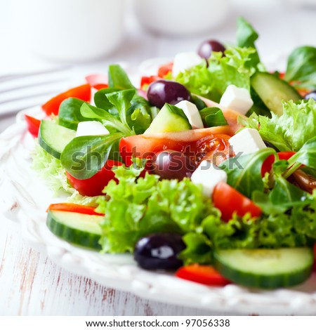 Mediterranean-Style Salad with Feta and Olives - stock photo