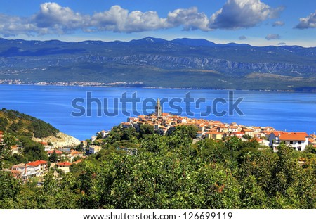 Mediterranean town of Vrbnik, Island of Krk, Croatia - town in northern Adriatic sea located on the high rock, known by the quality wine - vrbnicka zlahtina. Velebit mountain in the back. - stock photo