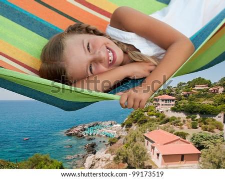 Mediterranean vacation - lovely girl in colorful hammock, Tolmezzo, Tuscany, Italy - stock photo