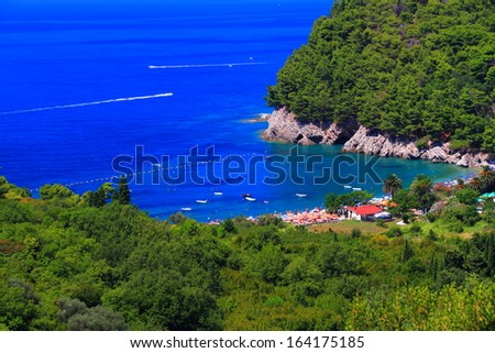 Mediterranean vegetation surrounds a small beach near the Adriatic sea - stock photo