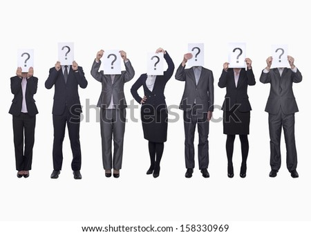Medium group of business people in a row holding up paper with question mark - stock photo