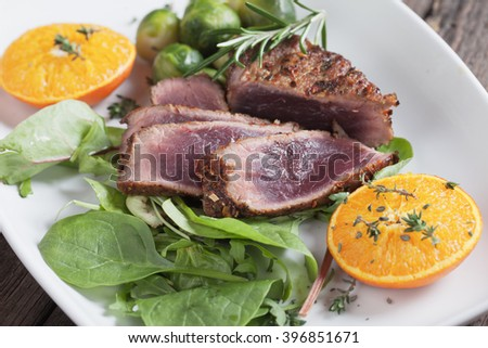Medium rare beef steak with herbs, lettuce and brussel sprout