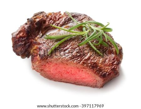 medium roast rib-eye steak isolated on white background - stock photo