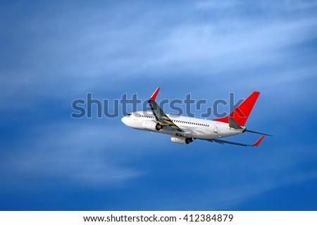 medium size, single aisle, most popular, twin engine passenger aircraft flying - stock photo