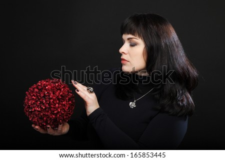 medium woman or fortune teller holds red magic ball - stock photo