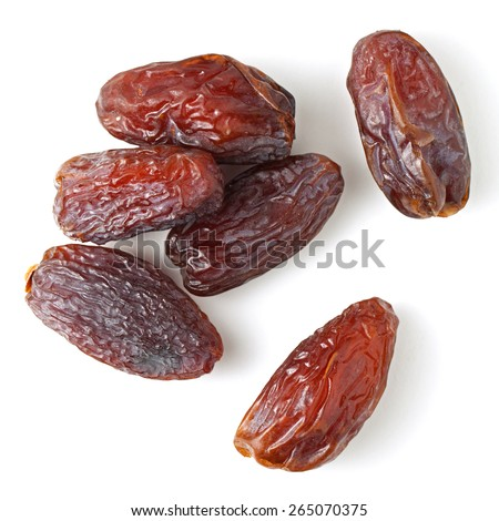 Medjool dates from above isolated on white background - stock photo