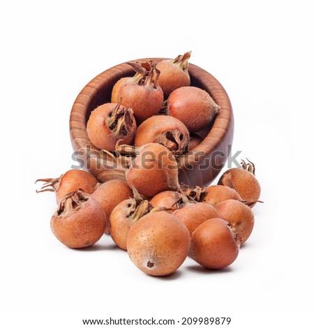 medlar fruit, isolated - stock photo