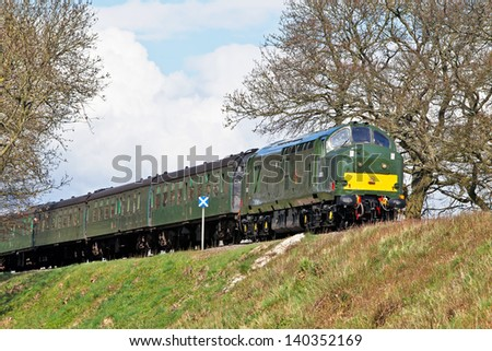 MEDSTEAD, UK - APRIL 26:A preserved ex British Railways class 37 diesel loco leaves Wanderers curve on the section toward Ropley giving short pleasure trips to passengers on April 26, 2013 in Medstead
