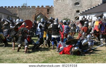 "MEDZHIBOZH, KHMELNITSKY REGION, UKRAINE - AUGUST 27: Knights battle on the field during the Festival of medieval culture ""Ancient Medzhybizh"" on August 27, 2011 in Medzhibozh, Ukraine - stock photo"