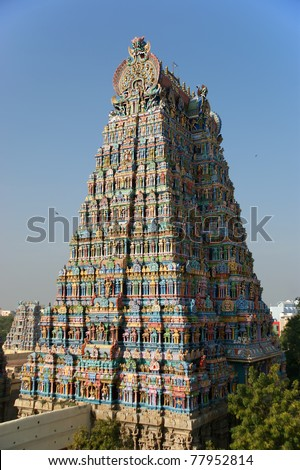 Meenakshi hindu temple in Madurai, Tamil Nadu, South India. Sculptures on Hindu temple gopura (tower). It is a twin temple, one of which is dedicated to Meenakshi, and the other to Lord Sundareswarar - stock photo