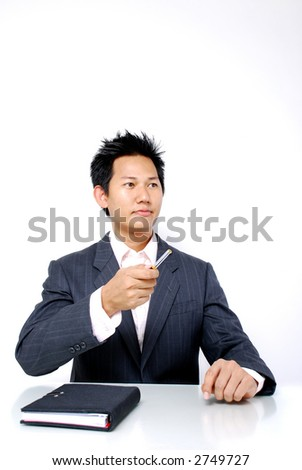 Meeting - Corporate man pointing using pen - stock photo