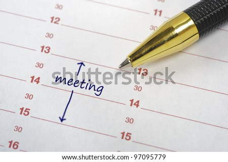meeting date in calendar - stock photo