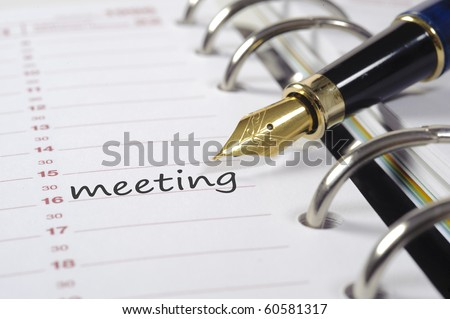 meeting date in diary - stock photo