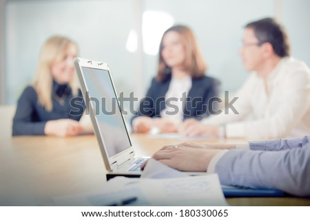 meeting,  hands behind your computer, on the back of the blurred people confer