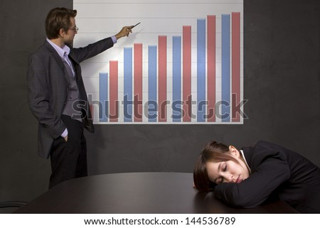meeting in a conference room with projector and chart - stock photo