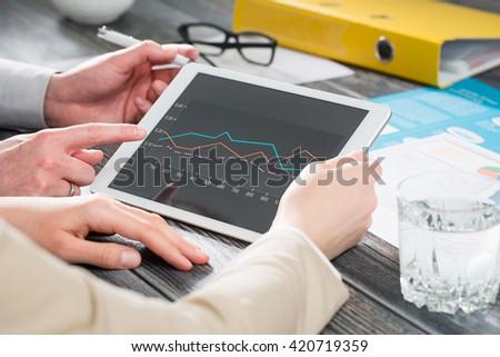 meeting leadership marketing diagram training planning tablet team - stock image - stock photo