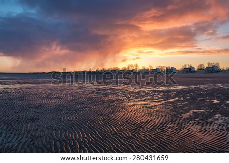 Meeting new day at the North Sea. - stock photo