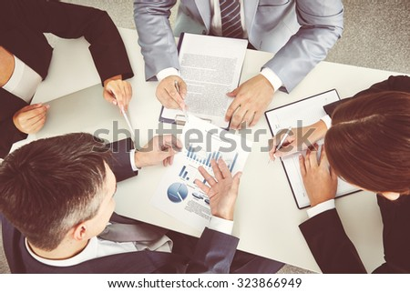 Meeting of colleagues during discussion of papers - stock photo