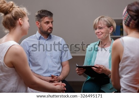 Meeting of support group in psychotherapist's room - stock photo
