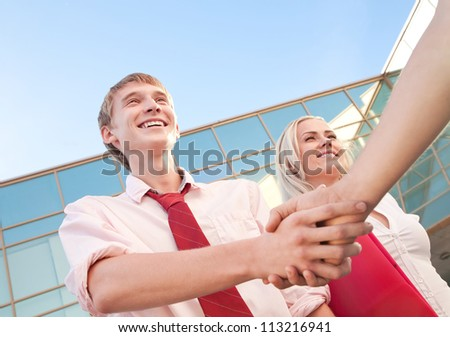meeting of three persons near the building - stock photo