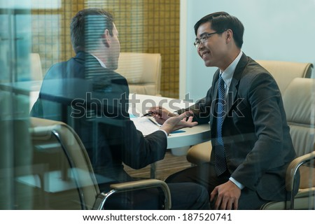 Meeting of two businessmen - stock photo