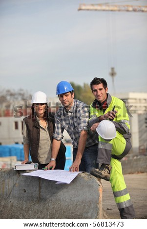 Meeting on a construction site - stock photo
