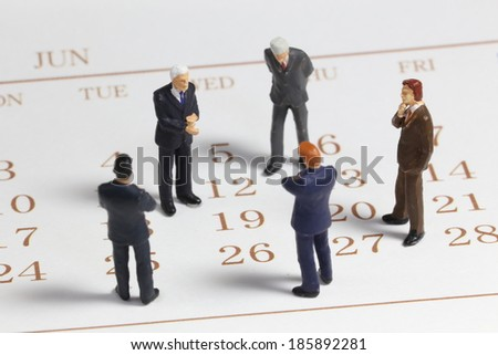Meeting on calendar - stock photo
