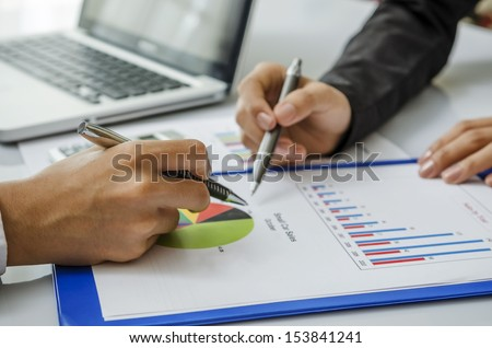 Meeting on chart - stock photo