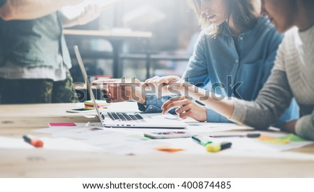 Meeting process.Photo young business managers crew working with new startup project.Notebook on wood table, typing keyboard.Using modern smartphones, texting message, analyze plans. Film effect, wide - stock photo