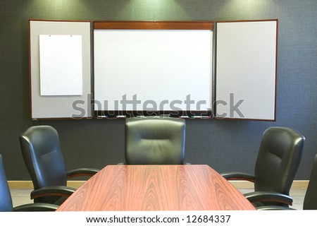 Meeting room and blank presentation board - stock photo