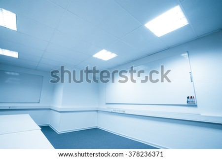 Meeting room with a large whiteboard in blue tone - stock photo