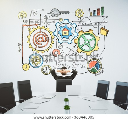 Meeting room with a table and a businessman sitting in a chair and looking at the wall with the drawn business plans - stock photo
