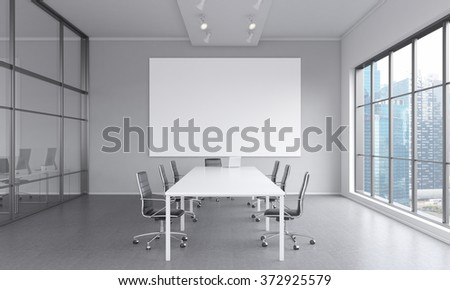 meeting room with a table in the center, a laptop on it, seven black chairs around it. A blank frame on the white wall. Window to the right. Front view. Concept of negotiations. 3D rendering - stock photo