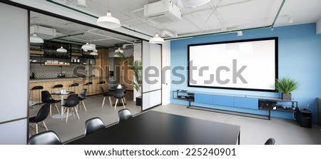 meeting room with projector in modern office - stock photo