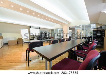 Meeting room with projector in modern office interior