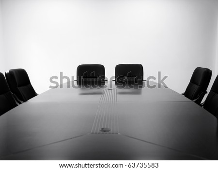 Meeting room with table and chairs. black and white - stock photo
