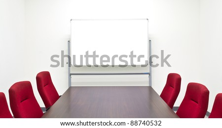 Meeting room with whiteboard - stock photo