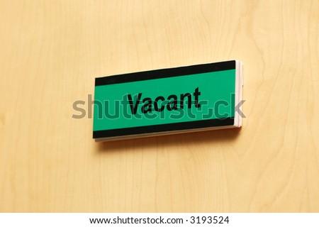 """Meeting room wooden  door with label """"vacant"""" - stock photo"""