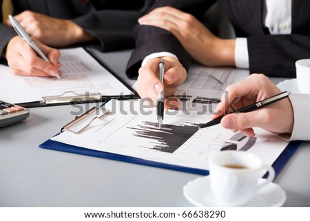 Meeting the team at the table. Only hands. - stock photo