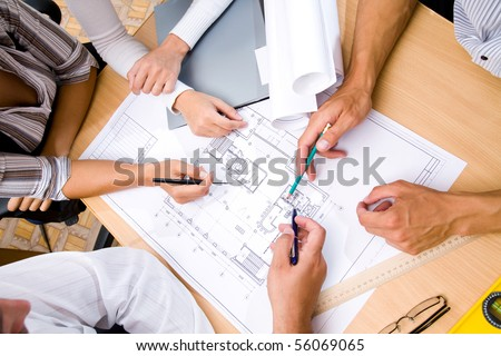 Meeting the team of engineers working on construction project at the table. Only hands.  Up view - stock photo