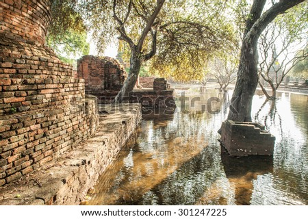 Mega flood at ancient temple in Ayuttaya historical park,Middle of Thailand. - stock photo